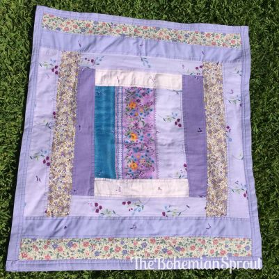 This lovely lavender 33 inch x 33 inch quilt is just heaven. I the turquoise stripe makes me smile every time I see it!